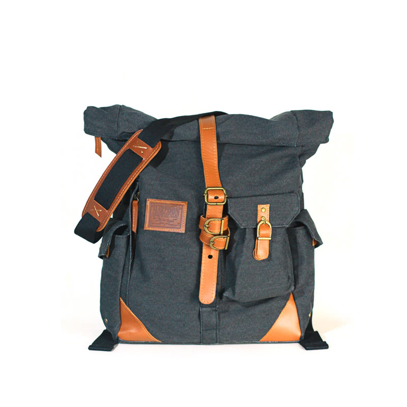 Rolltop bag crafted with durable waxed cotton canvas with leather details